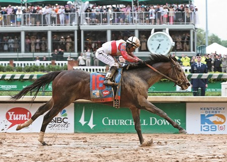 Orb and jockey Joel Rosario wins the 2013 Kentucky Derby at Churchill Downs.