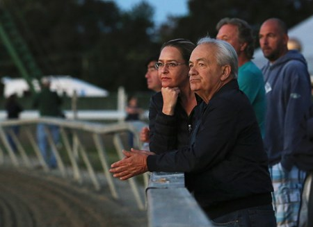 Trainer Jerry Hollendorfer and assistant Christina Jelm watch as Songbird gallops during training hours on September 22, 2016 at Parx Racing in Bensalem, Pennsylvania.