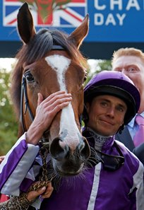 Minding and Ryan Moore after their win in the 2016 Queen Elizabeth II Stakes at Ascot