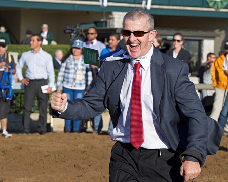David Carroll, assistant trainer for Mark Casse, celebrates.