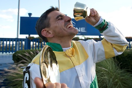 Jockey Eurico Da Silva  takes a siip from the Cup after guiding Chiefswood Stable's Tiz a Slam to victory in the 2016 Cup and Saucer Stakes