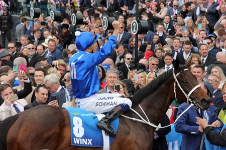 Jockey Hugh Bowman celebrates his 2016 Cox Plate win on Winx
