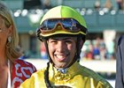 Jockey Angel Cruz is all smiles in the Alcibiades Stakes.