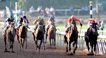 November 4, 2016: Beholder (orange) and Songbird battle down the stretch in the Breeders' Cup Distaff.
