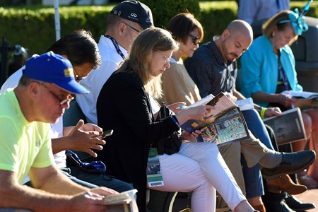 Fans handicap at the Breeders Cup at Santa Anita, Saturday, November 5, 2016.