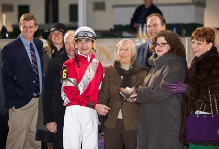 Trainer Ian Wilkes (behind jock), Janis Whitham (brown scarf), Clay Whitham (behind gal in glasses) Linda with Brian Hernandez Jr. wins the Mrs. Revere (gr. II) for Whitham Thoroughbreds and Ian Wilkes on Nov. 25, 2016, at Churchill Downs.