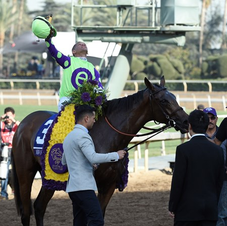 Javier Castellano celebrates after wining the Juvenile Fillies Turf (gr. I) on New Money Honey at Santa Anita on Nov. 4, 2016, in Arcadia, California.