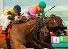 Ring Weekend (left) holds of Vyjack and Om to win the Seabiscuit Handicap