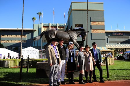 Fans take a picture in front of a statue of Zenyatta at the Breeders Cup at Santa Anita, Saturday, November 5, 2016.