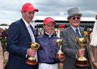 2016 Melbourne Cup winner Almandin's trainer Robert Hickmott, jockey Kerrin McEvoy, and owner Lloyd Williams (left to right).