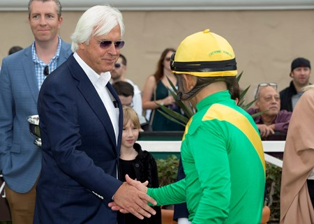 Trainer Bob Baffert, left, celebrates with jockey Mike Smith, right, after Mastery's victory in the Grade III, $100,000 Bob Hope Stakes