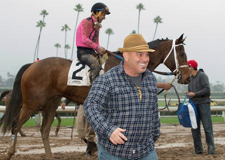 Trainer Peter Miller celebrates a dead heat win with his two thoroughbreds in the Grade III, $100,000 Midnight Lute Stakes, Saturday, December 31, 2016 at Santa Anita Park, Arcadia CA.