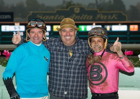 Trainer Peter Miller, center, celebrates with jockey Kent Desormeaux who rode St. Joe Bay, left, and jockey Victor Espinoza who rode Solid Wager, right, in a dead heat victory in the Grade III, $100,000 Midnight Lute Stakes, Saturday, December 31, 2016 at Santa Anita Park, Arcadia CA.