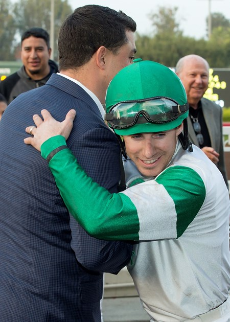 Abel Tasman's trainer Simon Callaghan. left. and jockey Joseph Talamo celebrate after winning the Grade I $300,000 Starlet on Saturday, December 10, 2016 at Los Alamitos Race Course, Cypress, CA.