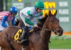 Abel Tasman and jockey Joe Talamo (in Clearsky Farms' silks) winning the Starlet Stakes