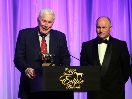 B.  Wayne Hughes along with trainer Richard Mandella accepts the Eclipse Award for Outstanding Older Dirt Female - Beholder at the 46th annual Eclipse Awards