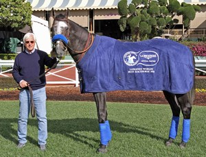 Two-time Longines World's Best Racehorse Arrogate with Hall of Fame trainer Bob Baffert after earning his first title
