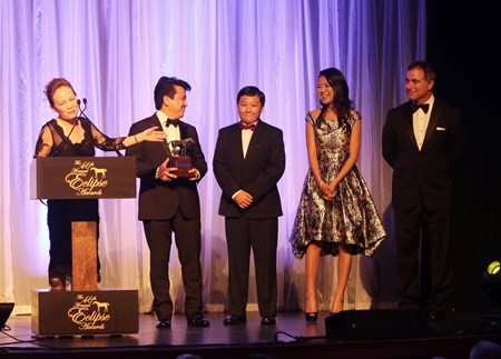 Susan and Charles Chu along with their son and friends accept the Eclipse Award for Champion Male Sprinter, Drefong, at the 46th annual Eclipse Awards