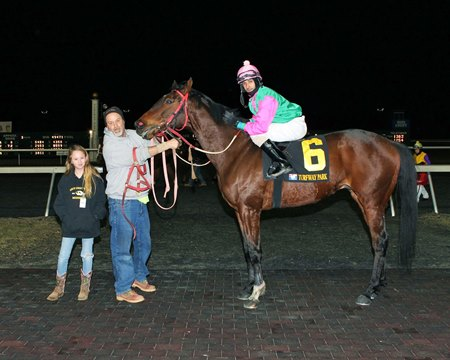 Hannah Schlenk (left), just 12 years old, won her first race as a horse owner Feb. 10 at Turfway Park
