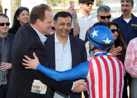 Trainer Doug O'Neill (left) and owner Kaleem Shah (center) celebrate Iliad's San Vicente victory with jockey Flavien Prat