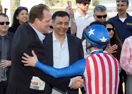 Trainer Doug O'Neill, left, and owner Kaleem Shah, center, celebrate with jockey Flavien Prat after Iliad's victory in the 2017 San Vicente Stakes (G2)