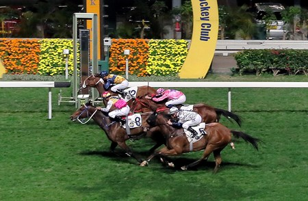 Blocker Dee (No. 8) and Sea Jade (No. 12), with Karis Teetan and Joao Moreira in the saddle respectively, land a dead-heat victory in the 2017 Happy Valley Trophy