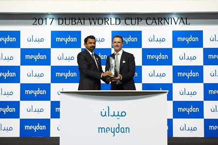 Charlie Appleby accepts the trophy for The Track Meydan Golf from Meghnad Warrier, Vice President  - Finance Meydan City Corporation
