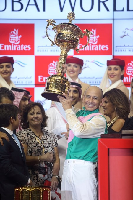 Mike Smith holds up the trophy after winning the 2017 Dubai World Cup aboard Arrogate