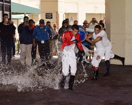 Apprentice Abimael Medina is showered with water by his fellow jockeys after winning the first race of his career March 17 at Gulfstream Park