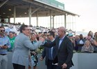 Tapwrit's owners celebrating his Tampa Bay Derby victory March 11