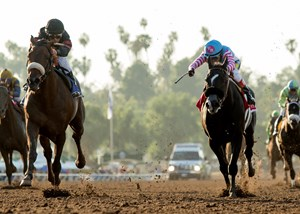 The Santa Anita Handicap, which was won in 2017 by Shaman Ghost (left) will see its purse dip to $600,000 in 2018