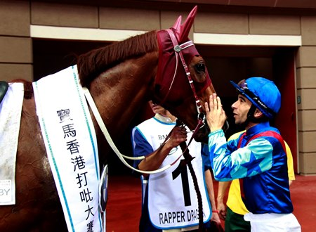 Jockey Joao Moreira has a moment with Rapper Dragon after taking the Hong Kong Derby