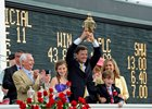 Graham Motion with Kentucky Derby trophy.