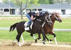 Girvin (outside) works April 15 at Trackside Louisville