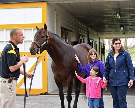 With Orb, l-r, Elizabeth Angell (pink), Sarah Angell (purple) with their mother Jill Angell. Horse Country tours at Claiborne Farm and Runnymede Farm in Paris, Ky., on March 30, 2017
