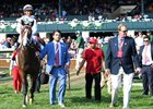 Preston Troutt of WinStar Farm leads American Patriot and Javier Castellano into the Keeneland winner's circle