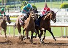 Battle of Midway (red cap) is a game runner-up to Gormley in the Santa Anita Derby