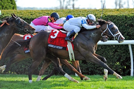 American Patriot (#3) Javier Castellano up, overtakes Heart To Heart (#9) and Conquest Panthera (middle) in deep stretch, to win the Gr.1 Maker's 46 Mile at Keeneland
