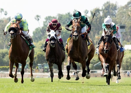 Paymaster Racing's Inordinate and jockey Corey Nakatani, second from right, outleg the field to win the Grade III, $100,000 San Juan Capistrano Stakes, Saturday, April 22, 2017 at Santa Anita Park, Arcadia CA.