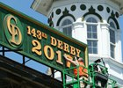 "A worker on April 10 updates the Kentucky Derby sign at Churchill Downs to ""2017"""