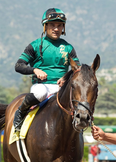Paymaster Racing's Inordinate and jockey Corey Nakatani, are guided into the winner's circle after their victory in the Grade III, $100,000 San Juan Capistrano Stakes, Saturday, April 22, 2017 at Santa Anita Park, Arcadia CA.