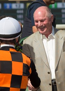 Richard Mandella shakes hands with jockey Flavien Prat after Paradise Woods' victory in the Santa Anita Oaks
