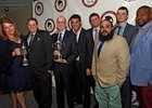 Accepting the award for NY Bred Horse of the Year are (from left to right): Samantha Will Baccari, Chad Summers, Scott Summers, Sol Kumin, Daniel Summers, and members of their farm staff at the Annual NYTB Awards