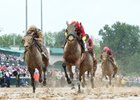 Daddys Lil Darling (outside) missed running down Abel Tasman in the Kentucky Oaks by 1 1/4 lengths