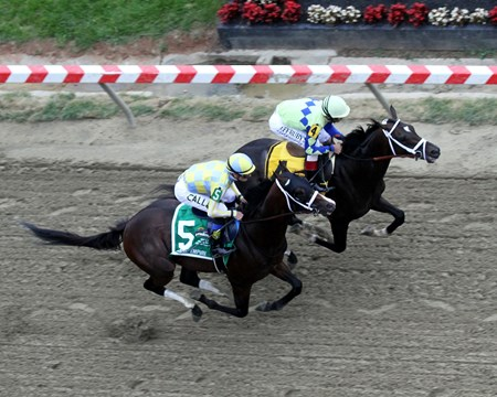Always Dreaming (#4) with John Velazquez and Classic Empire (#5) with Julien Leparoux go by the finish line the first time during the 142nd Running of the Preakness Stakes at Pimlico on May 20, 2017.