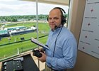 Travis Stone in the Churchill Downs announcer's booth