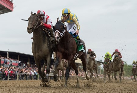 Cloud Computing with jockey Javier Castellano, left catches Classic Empire with jockey Julien Leparoux at the wire to win the 142nd running of the Preakness Stakes Saturday May 20, 2017 at Pimlico Race Course in Baltimore, MD.