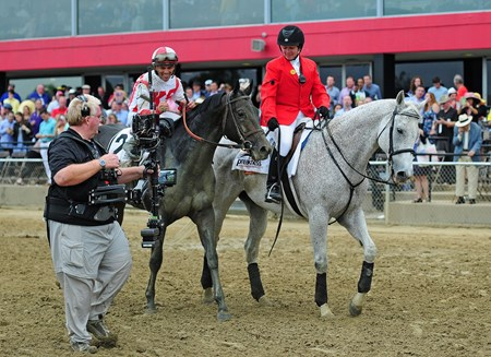 Javier Castellano on his way to the winners' circle, after winning the 142nd Preakness Stakes on Cloud Computing
