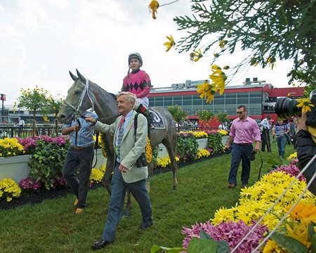 Trainer Jason Servis walks Actress to the winner's circle after the Black-Eyed Susan