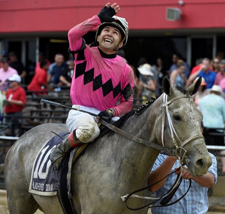 Jockey Nik Juarez is jubilant after winning the 92nd running of The Black-Eyed Susan on Actress May 19, 2017 at Pimlico Race Course in Baltimore, MD.